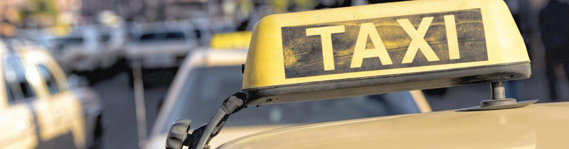 taxi_sign_on_roof_of_cab