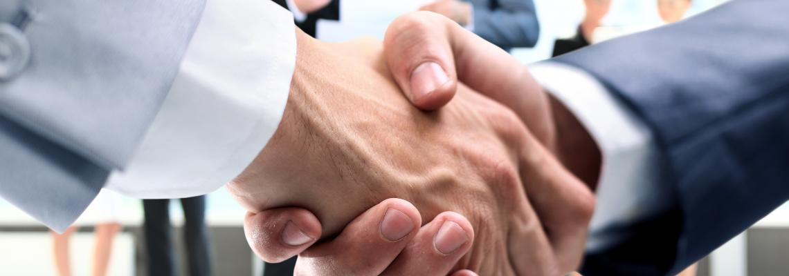 Men shaking hands closing partnership deal