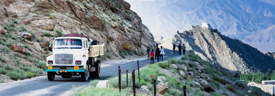 mountain road truck and people