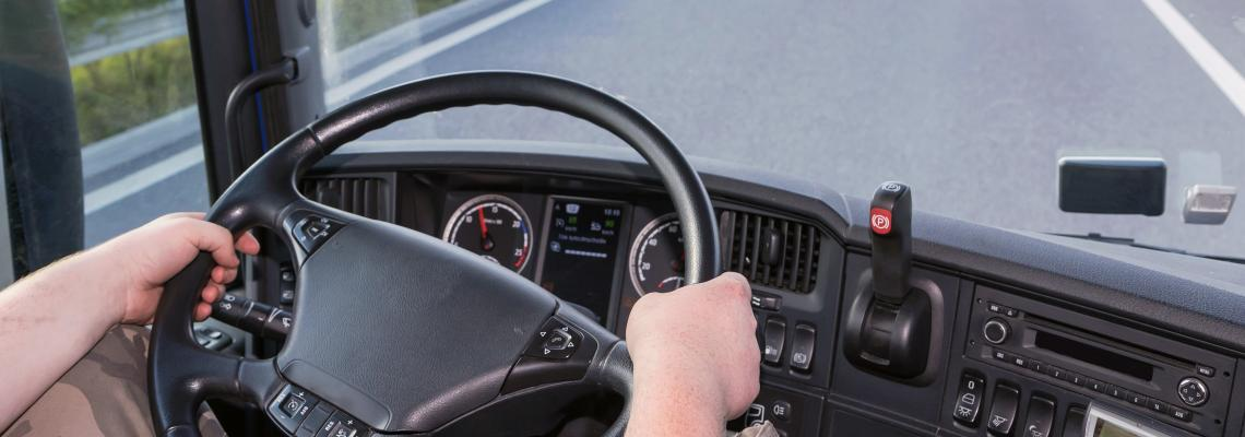 driver_driving_its truck_on_a_highway