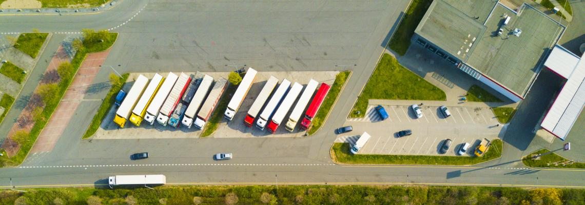 Aerial view of highway rest area with restaurant and large car park for cars and trucks