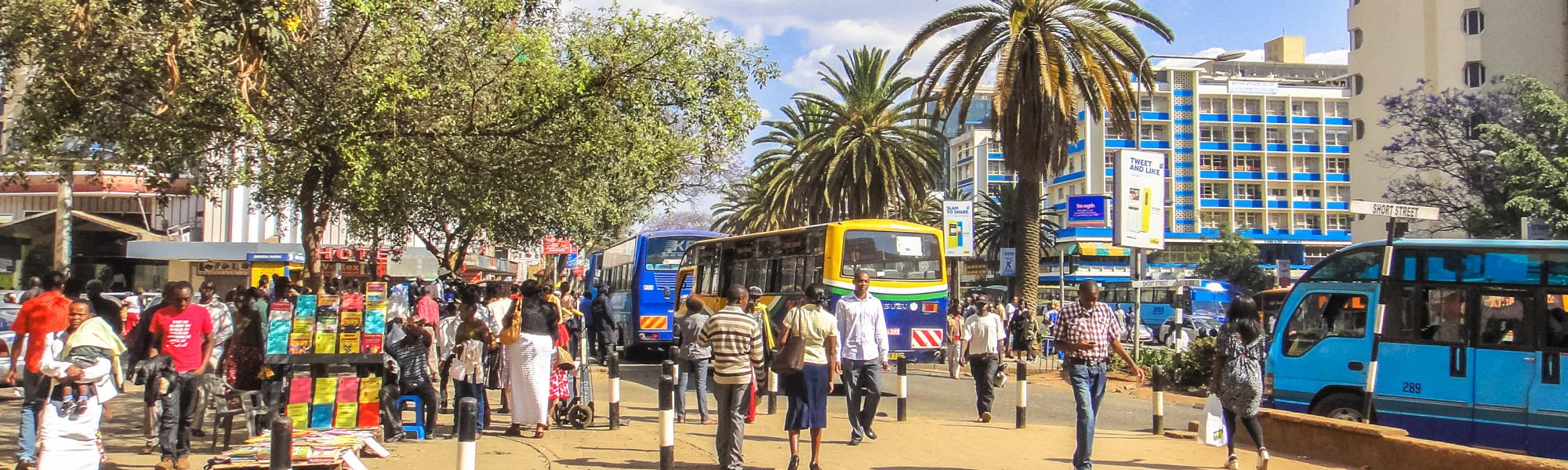buses in central Nairobi Kenya with people