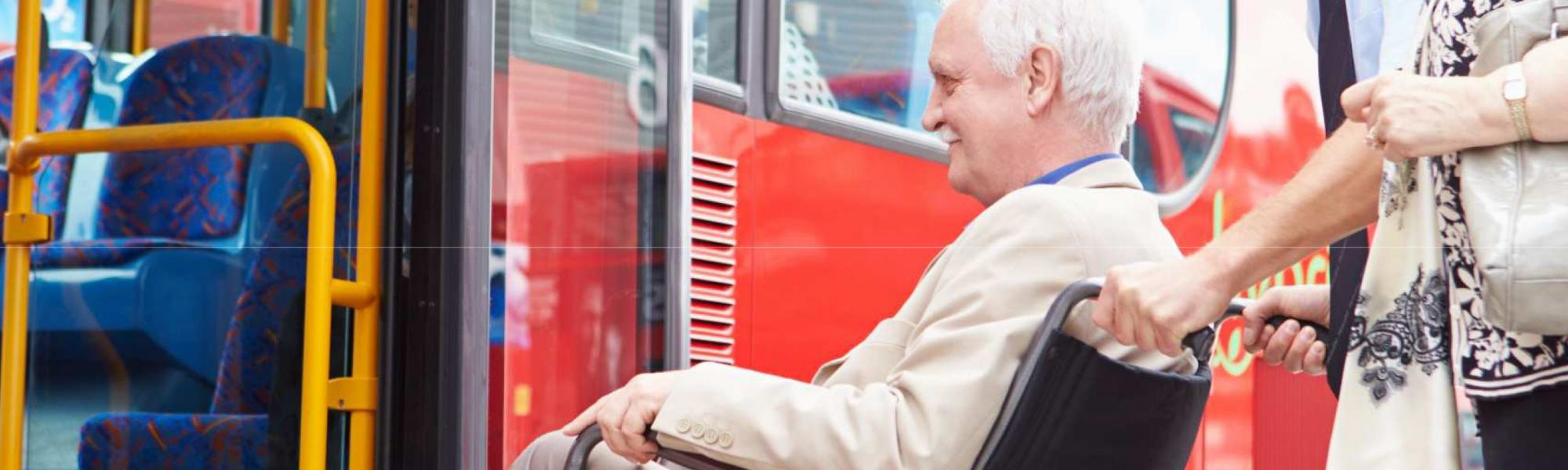 accessibility person in wheelchair getting on bus