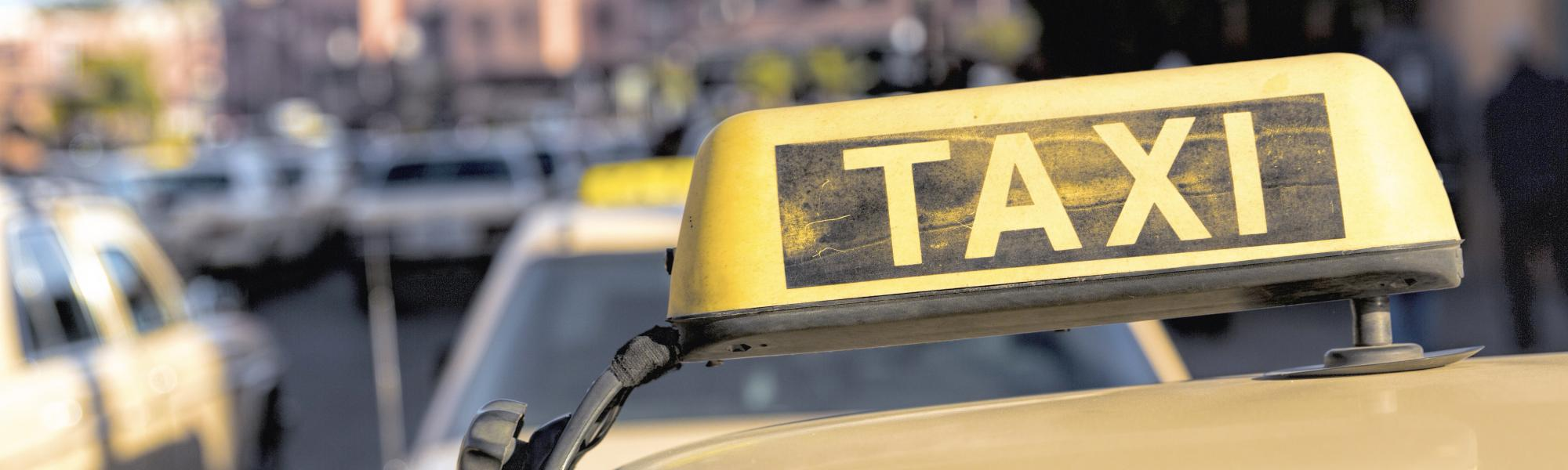 Taxi sign on the roof of the cab