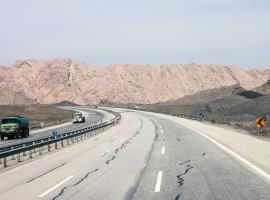 road near Tehran with trucks and road signs