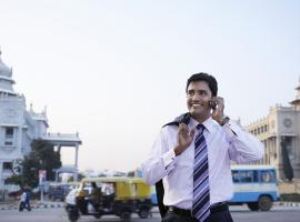 Inclusive and sustainable transport man with mobile phone Asia India