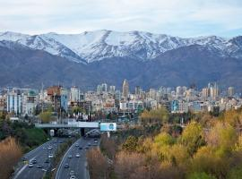 Tehran road and mountains with city